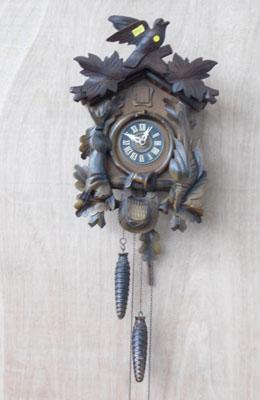 Vintage cuckoo clock w/o slight damage to birds beak and leaves