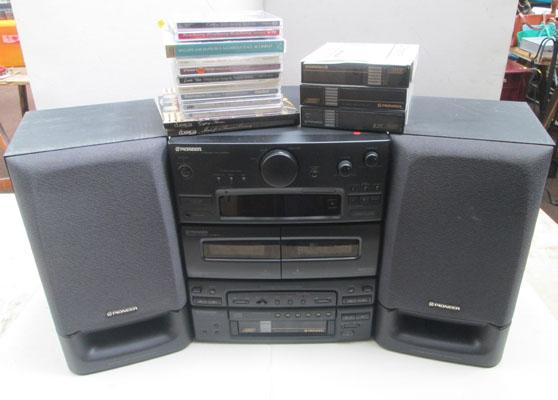 Pioneer stereo system with accessories-remote in office