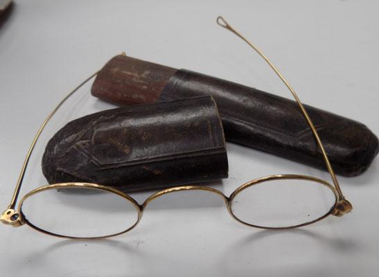 Pair of vintage yellow metal spectacles in caes