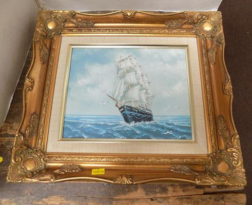 Ornate gold framed painting on board
