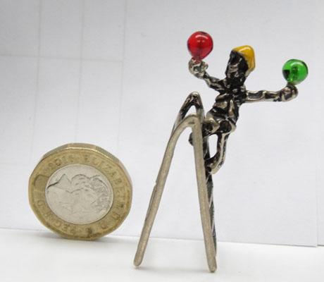Solid silver man on ladder balancing 2 balls
