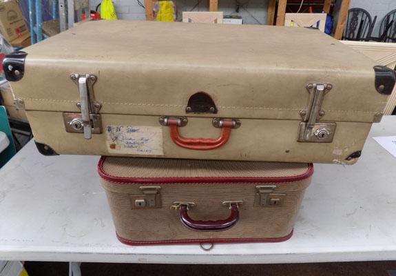 2 vintage suitcases, one with trouser hanger, one from India with bright blue linen lining.