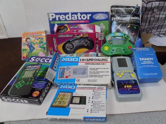 Box of electronic hand held games & others