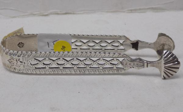 Pair of antique silver sugar tongs - London 1897
