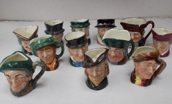 12 miniature Royal Doulton Toby jugs