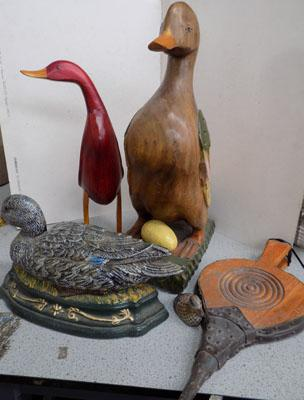 2 wooden ducks and a heavy metal door stop