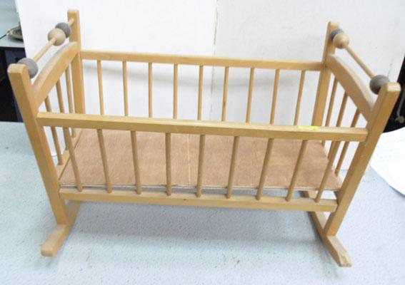 Toy rocking cradle