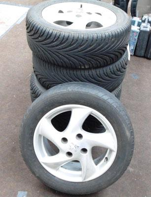 5 Peugeot 206 alloy wheels with 4 very good tyres