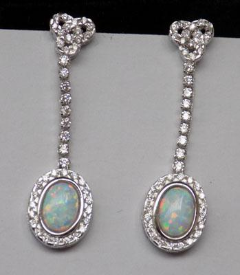 Pair of silver and opal set earrings