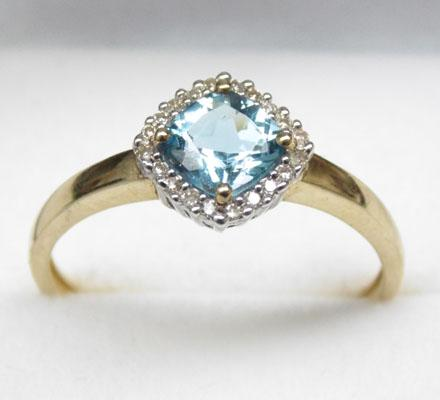 9ct gold diamond and 1ct London blue topaz ring - Size U