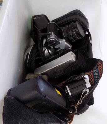 Container of cameras and cases, headphones etc.