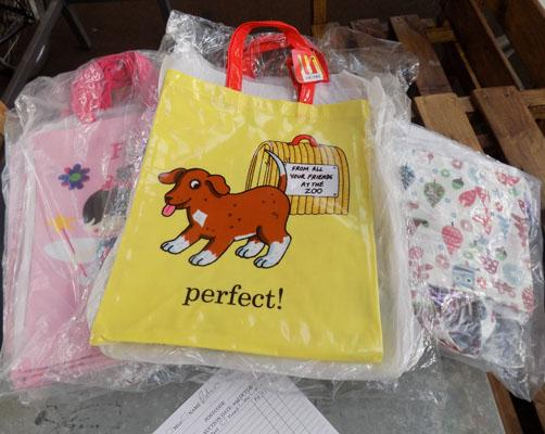 Approximately 30 new tote bags