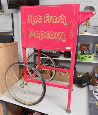 Vintage style popcorn cast advertising sign