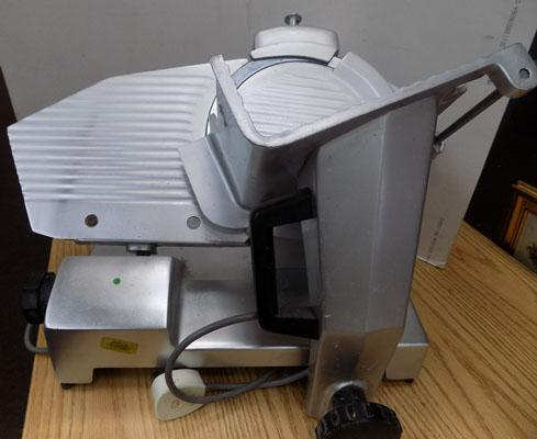 Stainless steel commercial meat slicer
