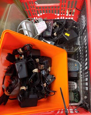Box of mobile phones, chargers, TV booster box etc.