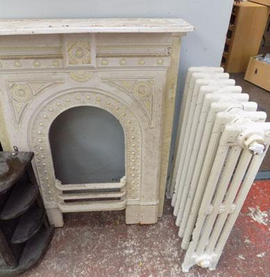 cast iron fireplace and radiator