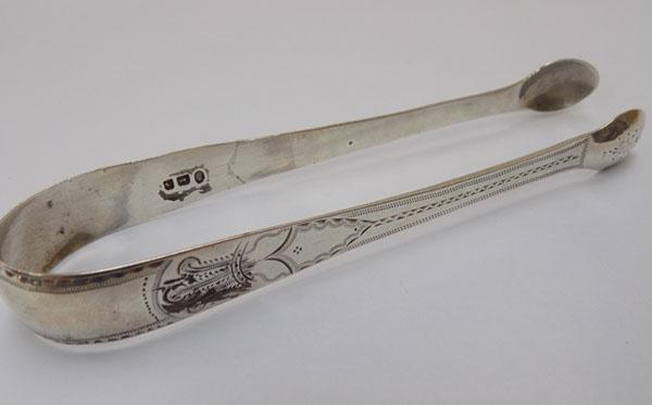 Large pair of antique silver sugar tongs