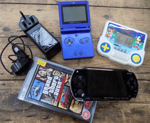 3 x handheld game consoles & a game