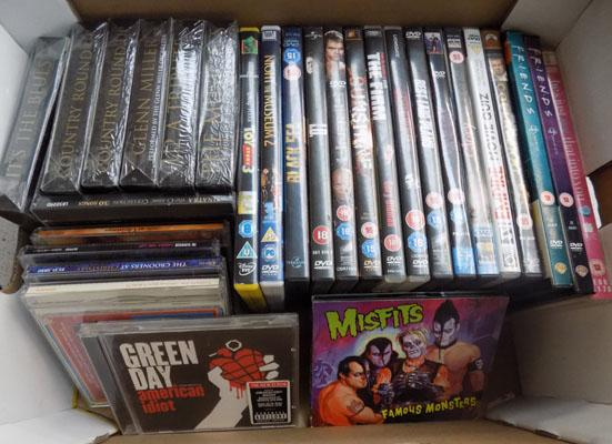 Box of DVDs and CDs