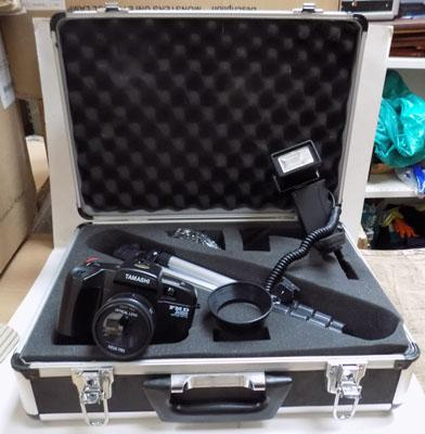 Cased Tamashi FMD system motor drive camera with tripod & flash