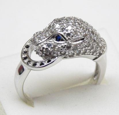 Silver and white topaz panthers head ring with sapphire eyes approx. size S
