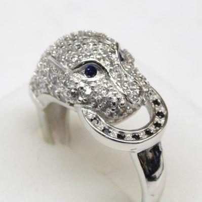 Silver and white topaz panthers head ring approx. size M