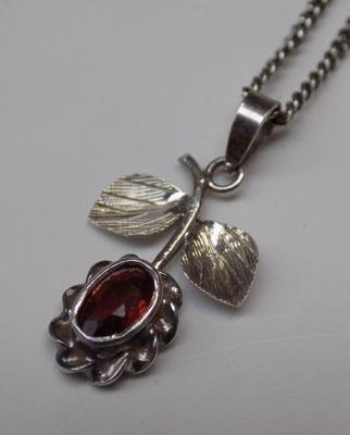 Petite silver and garnet pendant on silver chain