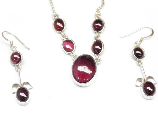 Silver and garnet matching necklace and earring set