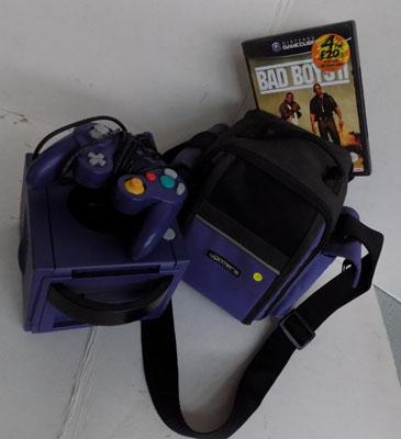 Game cube in case and game