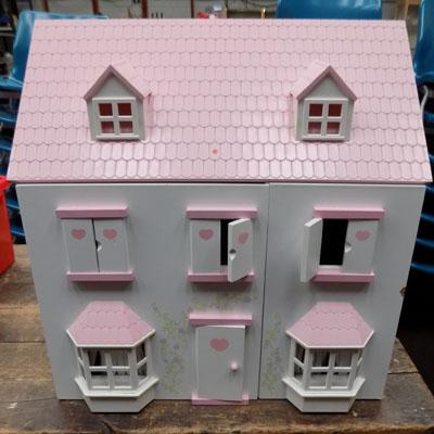 Large dolls house with figures and furniture