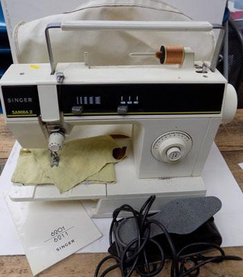 Singer sewing machine with foot pedal