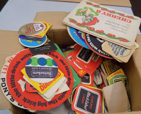 Box of vintage beer mats