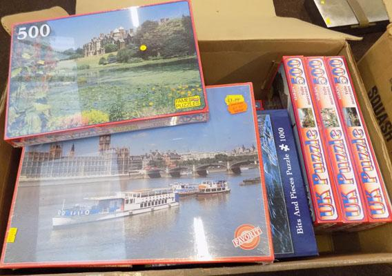 Box of jigsaw puzzles (some sealed)