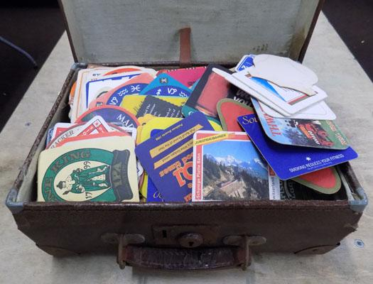 Vintage suitcase with beer mats