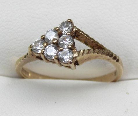 9ct gold ring set with 6 white stone in a triangle size N1/2