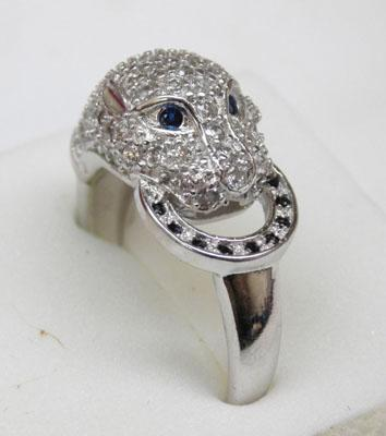 925 silver ring covered with white topaz and has sapphire eyes size Q