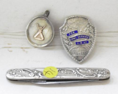 Silver pen knife, silver cricket medal and silver long service medal