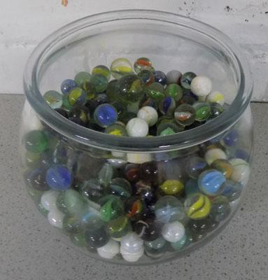 Large collection of marbles in glass bowl