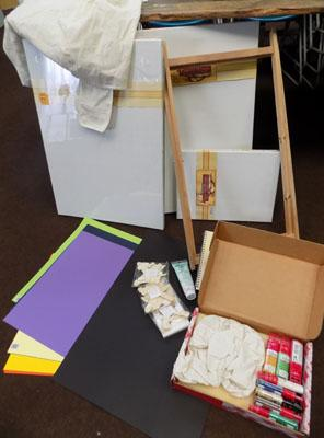 Selection of craft items including canvases, coloured cards and pet lollipop sticks