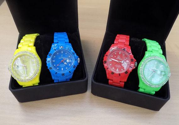 Set of 4 coloured boxed watches