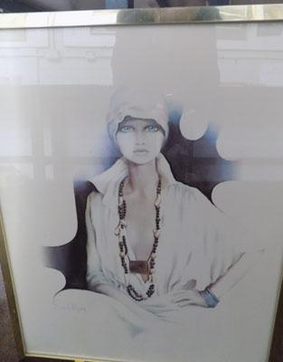 Framed picture of woman by Sara Moon