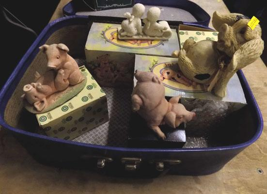 1 suitcase with boxes of pigs