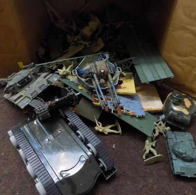Box of vintage plastic soldiers and tanks