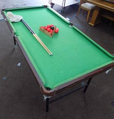 Folding snooker table with balls and cues