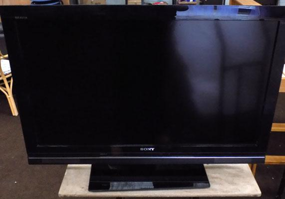 Sony TV with manual and remote (remote in office)