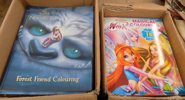 Two boxes of Tinkerbell & Winx Club colouring books