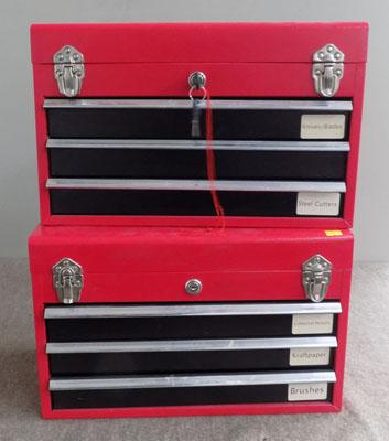 2 Lockable red boxes + keys (in office)