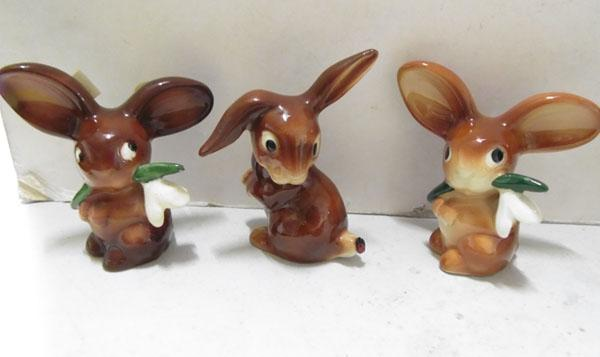 Three West German pottery bunnies