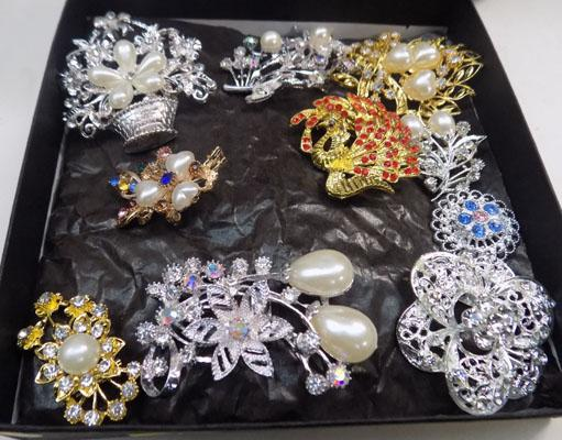 Box of costume brooches