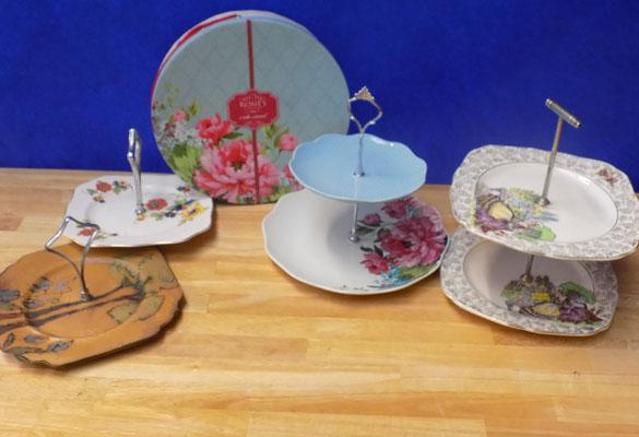 Four decorative cake stands in good condition